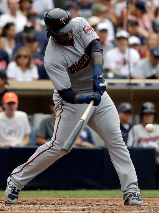"FILE - In this Aug.2, 2017, file photo, Minnesota Twins' Miguel Sano hits a home run during the sixth inning of a baseball game against the San Diego Padres in San Diego. Sano will not be suspended by Major League Baseball after being accused of assault. The commissioner's office said in a statement on Friday, March 23, 2018, that ""there was insufficient evidence to support a disciplinary determination against Sano, due to conflicting and inconsistent witness accounts and the absence of contemporaneous substantiation."" (AP Photo/Gregory Bull, File)"