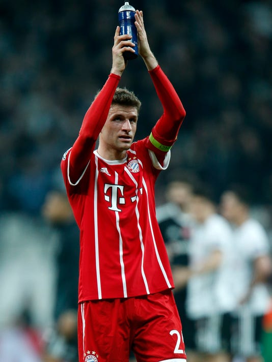 Bayern's Thomas Mueller waves to his fans after the Champions League, round of 16, second leg, soccer match between Besiktas and Bayern Munich at Vodafone Arena stadium in Istanbul, Wednesday, March 14, 2018. Bayern won 3-1. (AP Photo/Lefteris Pitarakis)