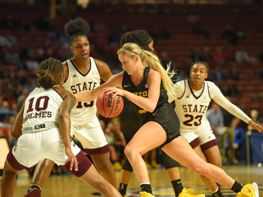 Missouri's Sophie Cunningham, center, drives against Mississippi State's Jazzmun Holmes (10) and Teaira McCowan during the first half of an NCAA college basketball game in the Southeastern Conference women's tournament Saturday, March 9, 2019, in Greenville, S.C. (AP Photo/Richard Shiro)