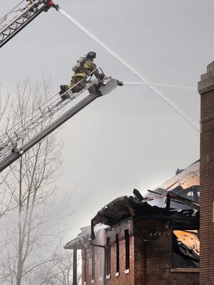 Wayne-Westland firefighters battle a blaze that destroyed a building that once housed a bakery at the Eloise complex.
