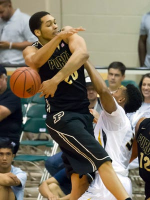 Purdue center A.J. Hammons, left, blocks Missouri forward Johnathan Williams III, right, shot in the second half of an NCAA college basketball game at the Maui Invitational on Tuesday, Nov. 25, 2014, in Lahaina, Hawaii. Purdue won 82-61. (AP Photo/Eugene Tanner)