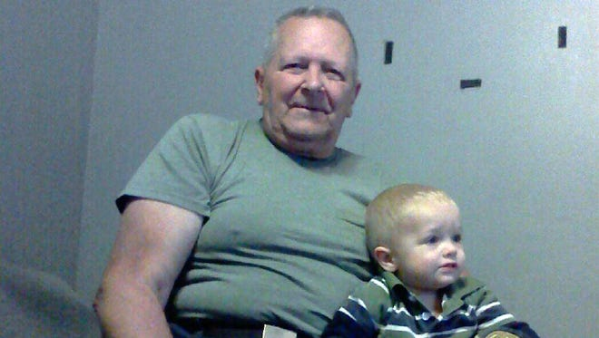 Clifford Van Haywald, 76, is shown with his 3-year-old great grandson, Sieth Staggers. Van Haywald was killed in a carjacking.