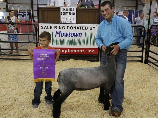 Tyler Kies of Batavia, Wis., shows his Grand Champion