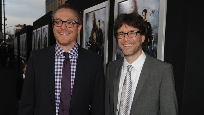 """""""Deadpool"""" writers Rhett Reese (left) and Paul Wernick, shown here attending a film premiere in 2013, met in high school and have written three feature films together."""