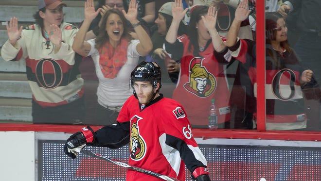 Ottawa Senators fans celebrate Mike Hoffman's tying goal in the third period.