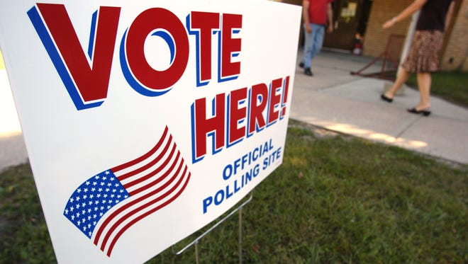 A sign lets voters know where to vote in front of the elementary school in Dell Rapids.