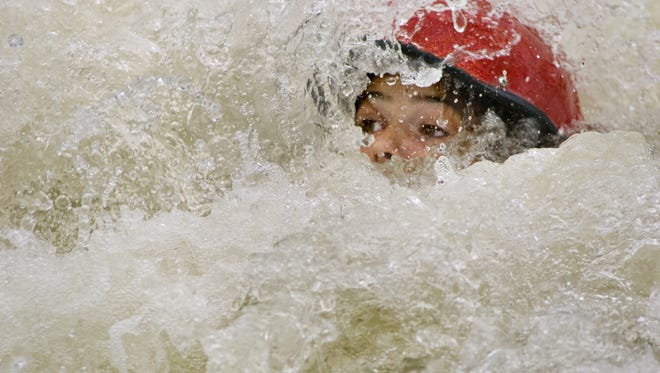 Emily Wafler, 13, of Pittsford was actually having fun body surfing during white water kayak class by Lock 32 on the canal in 2008 in Pittsford