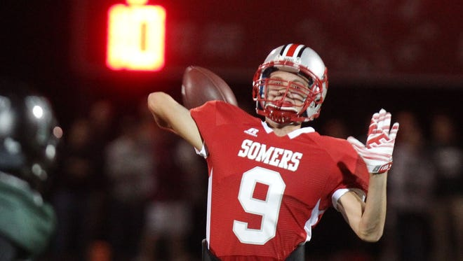 Somers quarterback Kevin Olifiers attempts a pass during last year's 38-21 victory over Yorktown. Olifiers and receiver Matt Pires enter this year's rematch with five touchdowns between them through two games.