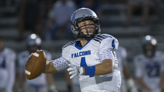 Catalina Foothills quarterback Rhett Rodriguez, seen throwing in a September game, is Arizona Wildcats coach Rich Rodriguez's son.