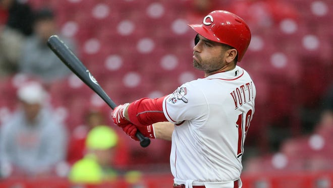 Cincinnati Reds first baseman Joey Votto (19) swings and misses in the first inning during the National League baseball game between the Atlanta Braves and the Cincinnati Reds, Tuesday, April 24, 2018, at Great American Ball Park in Cincinnati.