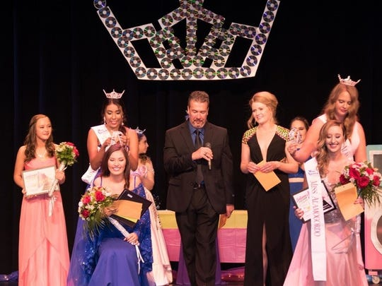 Miss Otero County Misa Tran receives her crown while Miss Alamogordo Teen Dallas Collins prepares to be crowned at the Flickinger.
