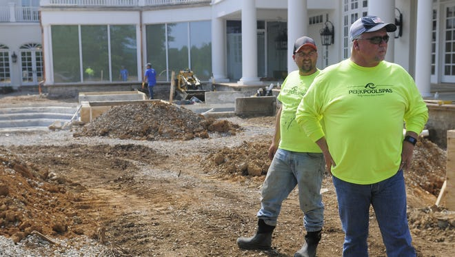 At a pool construction site in Williamson County, Justin Peek, left, and his father, Kyle, pondered if anything would be different after their reality show aired.
