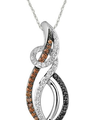 Boxes of chocolates for sale this holiday season come with a chance to win this chocolate and white diamond pendant from C.W. Smith Jewelers, valued at $1,000. The winner will be drawn at Chocolate Fantasy on Sunday, Jan. 31, 2016.
