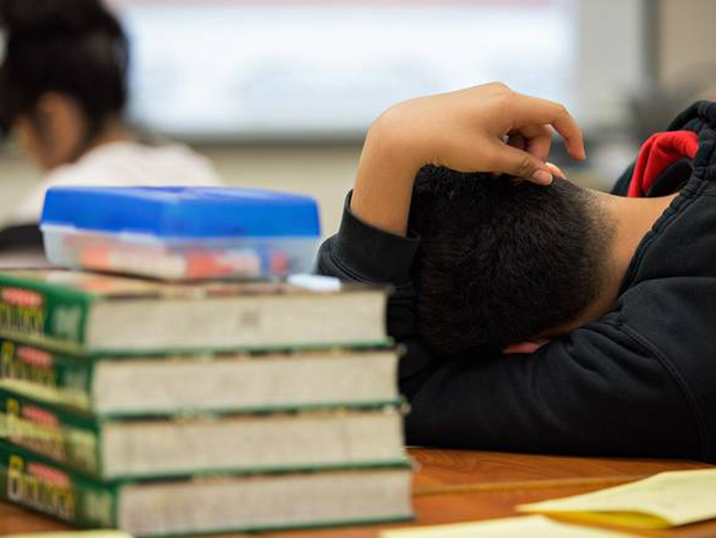 A student at the Elsik Ninth Grade Center rests during