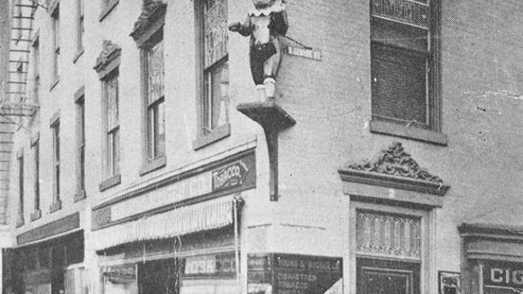 By around 1915 Punch was even more prominent on his own high shelf at the corner of George Street and the Square.