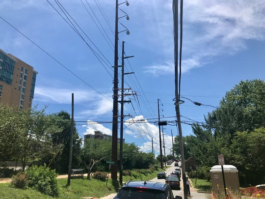 Duke Energy is installing 22 new 100-foot steel utility poles in the I-240 area near downtown. The poles will carry transmission and distribution lines once the $16-million project is completed in September. The older, wooden poles will be removed at that time.
