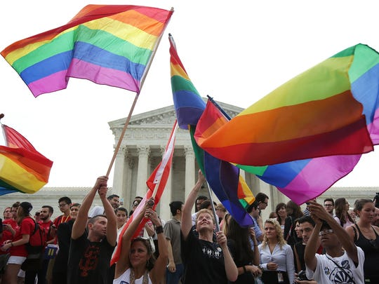 Same-sex marriage supporters rejoice after the U.S Supreme Court hands down its ruling on same-sex marriage on June 26, 2015.