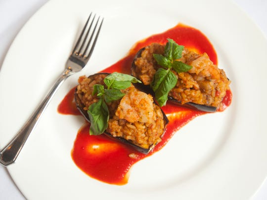 Stuffed eggplant with rice and tomato sauce, also known