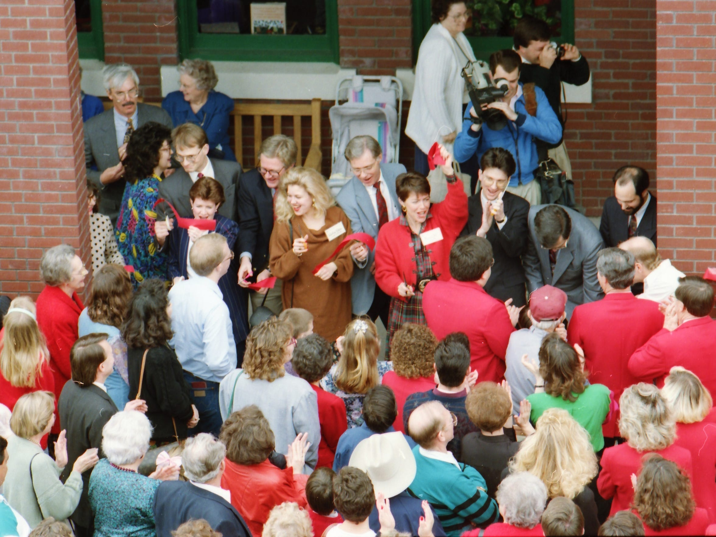 The ribbon is cut to open what would be named The Grace Museum in downtown Abilene in February 1992. Board president Bob Nutt can be seen in the dark suit near the center of the photograph.