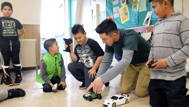 From left, Tony Castro, 11, Frankie Caballero, 6,  Omar Canseco, 7, city employee Hugo Ambriz, 20, and Onesimo Gallardo, 10, take their marks in a car race Monday afternoon at the Hebbron Center in east Salinas.