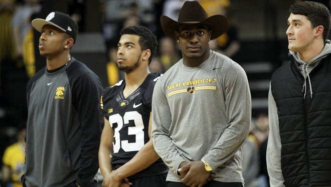 Iowa's Desmond King is shown during Wednesday's halftime ceremony honoring the Hawkeye football team's 12-2 season. At left are Tevaun Smith and Jordan Canzeri.