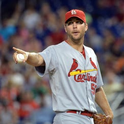 Aug 12, 2014; Miami, FL, USA; St. Louis Cardinals starting pitcher Adam Wainwright (50) points on the pitching mound during a game against the Miami Marlins at Marlins Ballpark. Mandatory Credit: Steve Mitchell-USA TODAY Sports