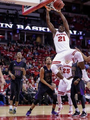 Wisconsin's Khalil Iverson (21) dunks over Prairie View A&M's Karim York (30), Admassu Williams (23) and Ja'Donta Blakely (25) during the second half of an NCAA college basketball game Wednesday, Nov. 25, 2015, in Madison, Wis. Wisconsin won 85-67.