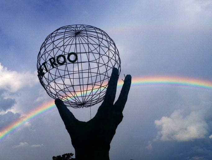 A rainbow formed over the Planet Roo statue at the Bonnaroo Arts & Music Festival in Manchester, Tenn., Thursday June 12.