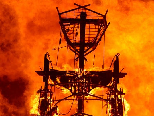 "The ""man"" burns in 2013 during Burning Man 2013 in"