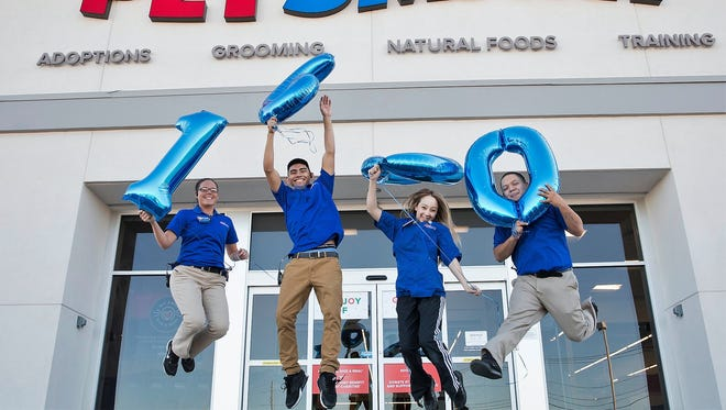 Employees at PetSmart's new store at 3790 Joe Battle Blvd., celebrate the recent opening of the East El Paso store, which is the Phoenix chain's 1,600th store in North America.
