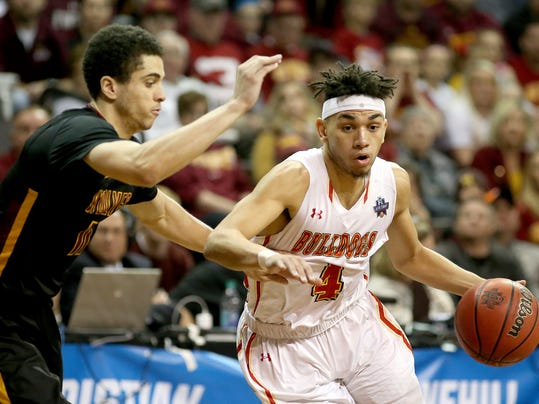 Ferris State's Drew Cushingberry (4) drives against Northern State's DJ Pollard (11) during the first half of the NCAA division II men's college basketball championship game, Saturday, March 24, 2018, in Sioux Falls, S.D. (AP Photo/Dave Eggen)