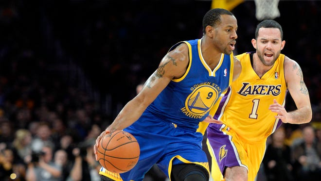 Andre Iguodala (9) drives against the Lakers in Friday's game before injuring a hamstring.