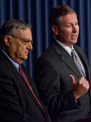 In this 2009 file photo, Maricopa County Sheriff Joe Arpaio, left, and Maricopa County Attorney Andrew Thomas, announce  that a grand jury indicted two county supervisors on dozens of charges each. All the charges ultimately were dropped or dismissed.