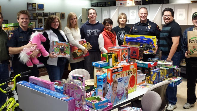 The Cops for Kids Foundation Christmas project included, from left: Fond du Lac Police Department staff – Lead Chaplain Paul Pfeffer and Officer Steve Olson; Cops for Kids Foundation volunteer Cathy Dreifuerst and Jennifer Walters, board president; Officer Ragan Pecore, FDLPD; Colleen Ahern, Foundation board member; Fond du Lac Police Department staff – Lieutenant Tina Braun, Chief Bill Lamb, Chaplain Grant Baumhardt and Chaplain Jeff Blain.