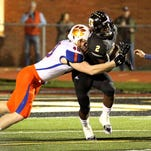 Starkville High quarterback Monrtario Montgomery (17) hands off to Avery Brown (2) during the first half of the 6A North Half championship game against Madison Central in Starkville on Friday.
