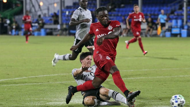 Toronto FC forward Ayo Akinola, front, scores his second goal of the game during the first half of an MLS match against Montreal on Thursday in Kissimmee.