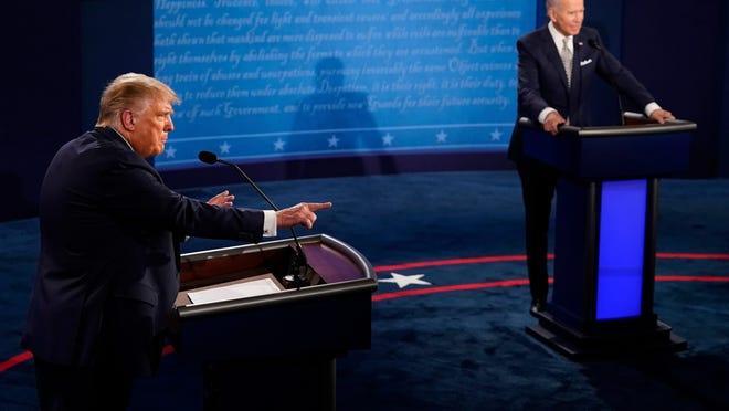 President Donald Trump makes a points as Democratic presidential candidate former Vice President Joe Biden listens during the first presidential debate on Sept. 29, 2020 in Cleveland, Ohio.