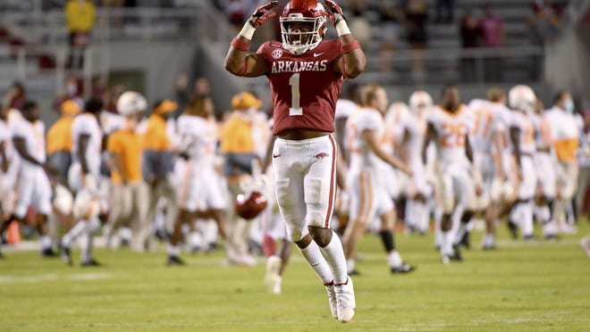 Arkansas defensive back Jalen Catalon (1) celebrates after beating Tennessee 24-13 on Saturday in Fayetteville.