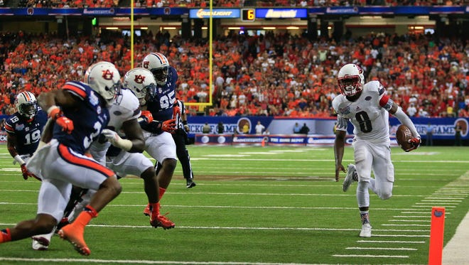 Louisville quarterback Lamar Jackson runs out of bounds near the goal line which set up a Brandon Radcliff touchdown in the fourth quarter. It wasn't enough as the Cards fell 31-24 to the Tigers.  Sept. 5, 2015