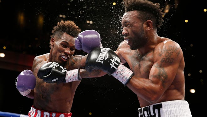 Las Cruces' Austin Trout, right, fights Jermall Charlo  in a junior middleweight title fight last May in Las Vegas. Charlo won by decision.