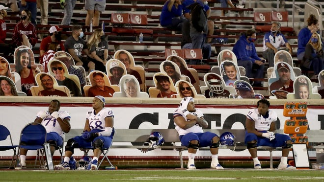 Kansas players react on the bench late in the Jayhawks' 62-9 defeat to No. 19 Oklahoma on Nov. 7 in Norman, Okla. KU will return to action for the first time in three weeks when it plays host to TCU at 7 p.m. Saturday at David Booth Kansas Memorial Stadium in Lawrence.