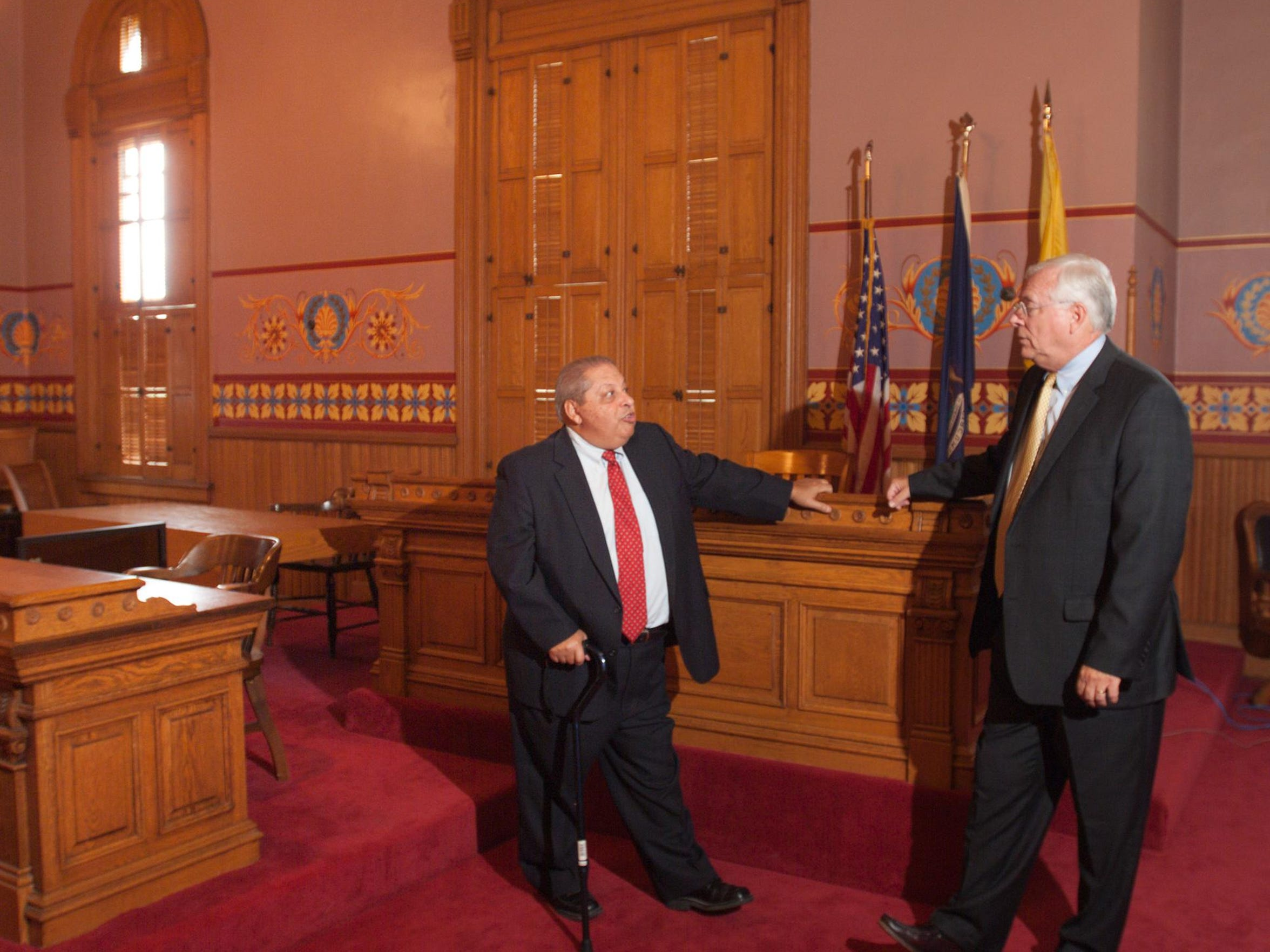 Judge Frank Del Vero, left, and former Livingston County Prosecutor David Morse talk about the logistics of the Shawn Moore case in 1985, held in the historic Livingston County Courthouse. Del Vero was the prosecuting attorney, and Moore was chief assistant prosecuting attorney at the time.