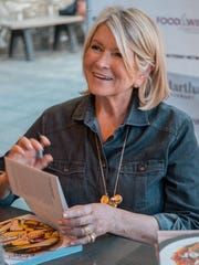 "Martha Stewart signs copies of her new cookbook, ""Slow Cooker,"" during the Detroit Free Press Food & Wine Experience in Detroit."