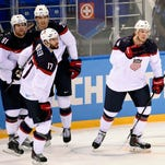 Feb 13, 2014; Sochi, RUSSIA; USA defenseman John Carlson (4) is congratulated by teammates after scoring a goal against Slovakia in a men's ice hockey preliminary round game during the Sochi 2014 Olympic Winter Games at Shayba Arena. Mandatory Credit: Richard Mackson-USA TODAY Sports