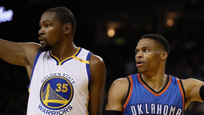 Kevin Durant of the Golden State Warriors and Russell Westbrook of the Oklahoma City Thunder point in different directions after the ball went out of bounds at ORACLE Arena on January 18, 2017.