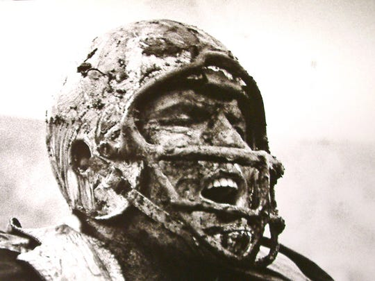 Packers offensive tackle Forrest Gregg cheers a good play by Green Bay's defense while covered in mud in a game against the San Francisco 49ers at Kezar Stadium, Dec. 10, 1960.