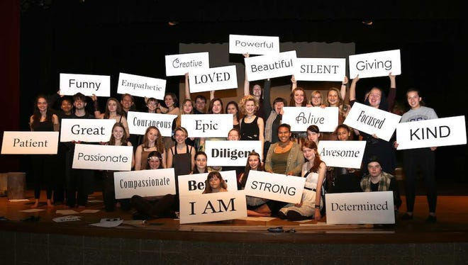 Participants of LEAP project pose with words that describe empowerment.