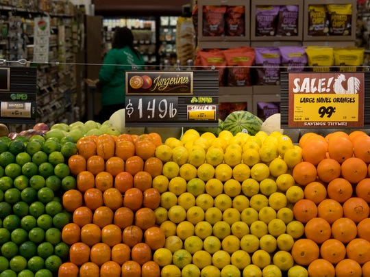 Citrus fruits are piled high at Fresh Thyme Farmers Market Wednesday afternoon in preparation for the next day's Evansville grand opening.