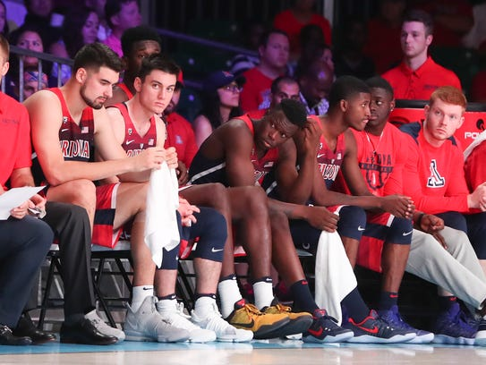 The Arizona Wildcats bench reacts during last week's