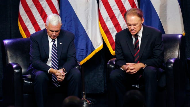 Mike Pence prays with Todd Hudnall, pastor of Radiant Church, in Colorado Springs on Sept. 22, 2016.